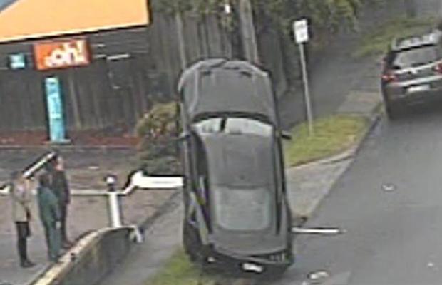 Mustang belly up: Car mounts pole wiring in Kew crash