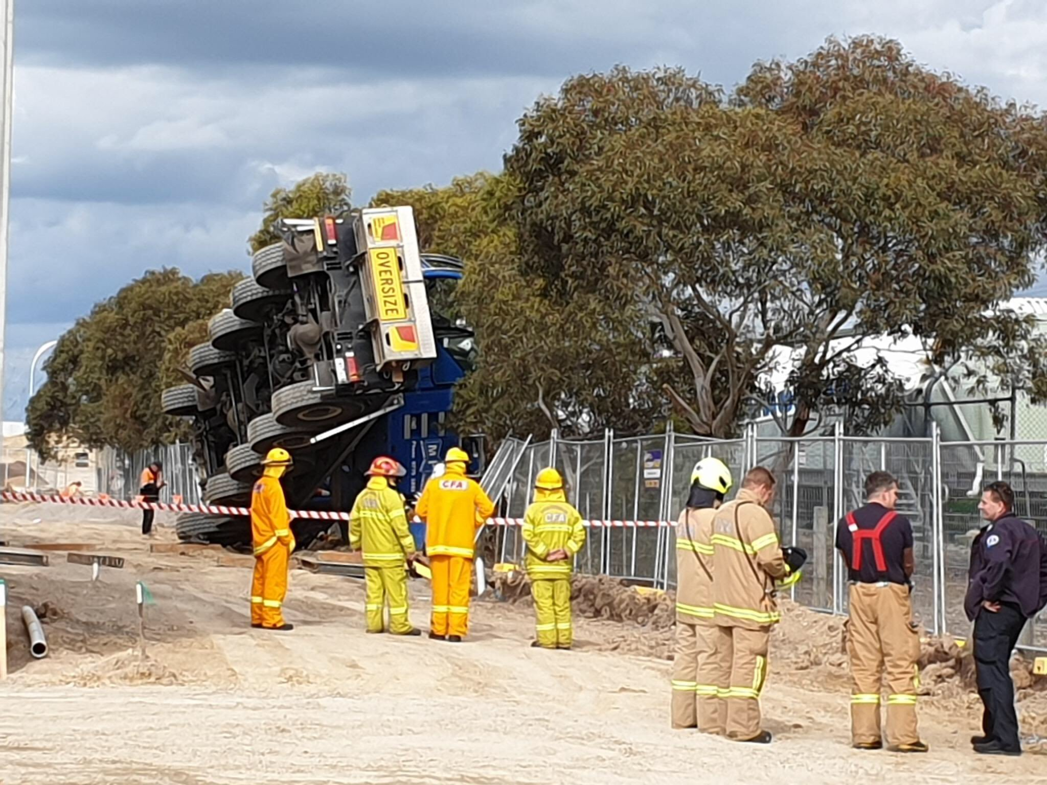 Article image for Crane topples at Clyde North, cutting power to thousands of homes