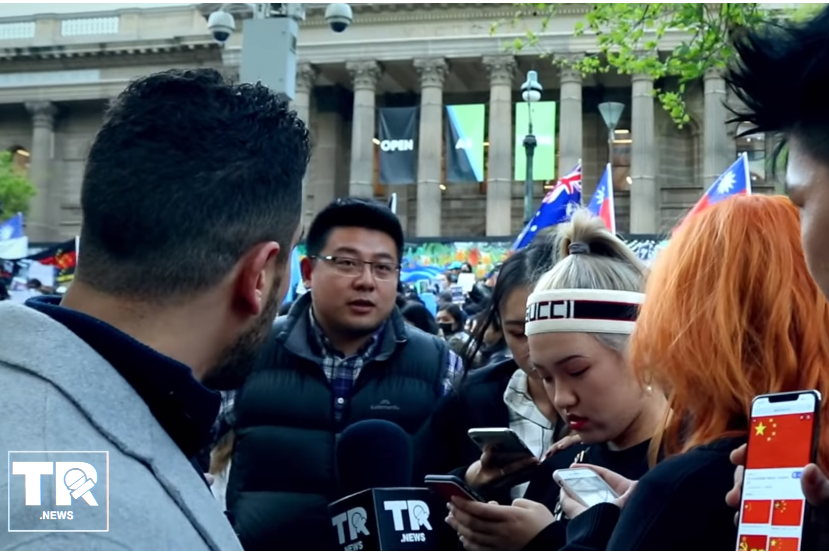 Article image for Video of alleged Chinese spy intimidating students at a Melbourne protest sparks foreign interference fears