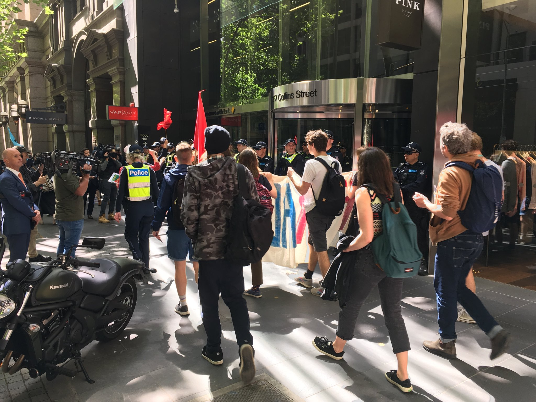 Article image for Anti-mining protesters block Collins Street as week of disruptions kicks off