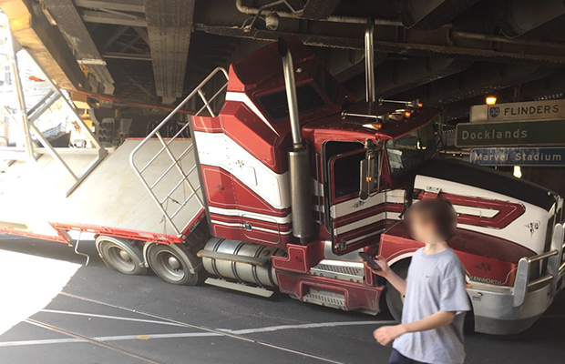 Article image for Truck stuck under bridge at major CBD intersection