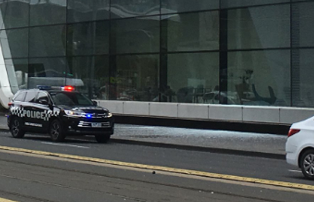 Article image for Glass falls from Crown Casino, shattering on Spencer Street footpath
