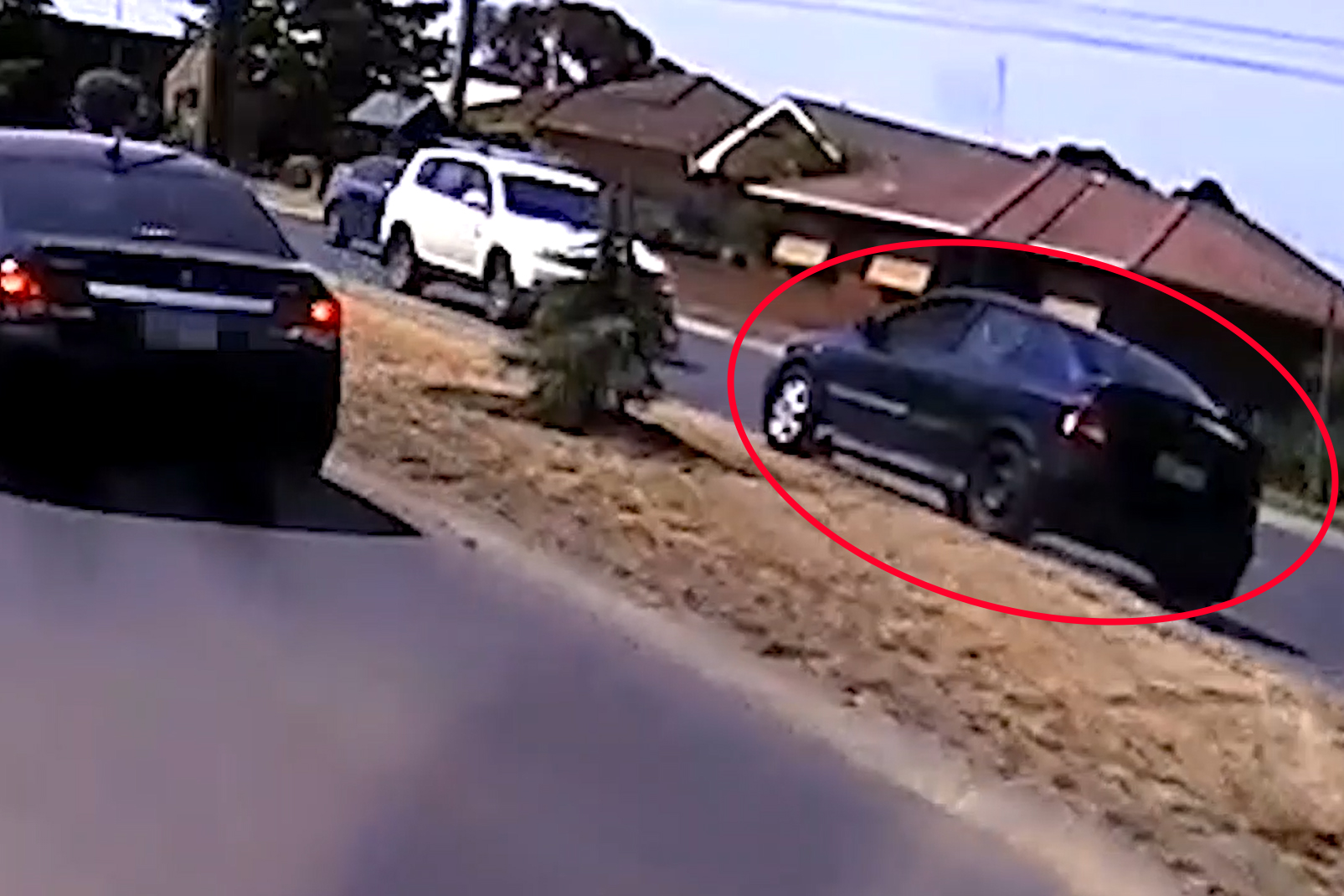 Article image for VIDEO: Shocking dash cam footage captures car going the wrong way through a busy roundabout