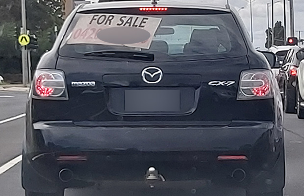 Article image for Debate breaks out over 'For Sale' sign on car's back window