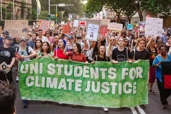 Article image for Climate protester says signs calling for ScoMo house to burn 'totally appropriate'