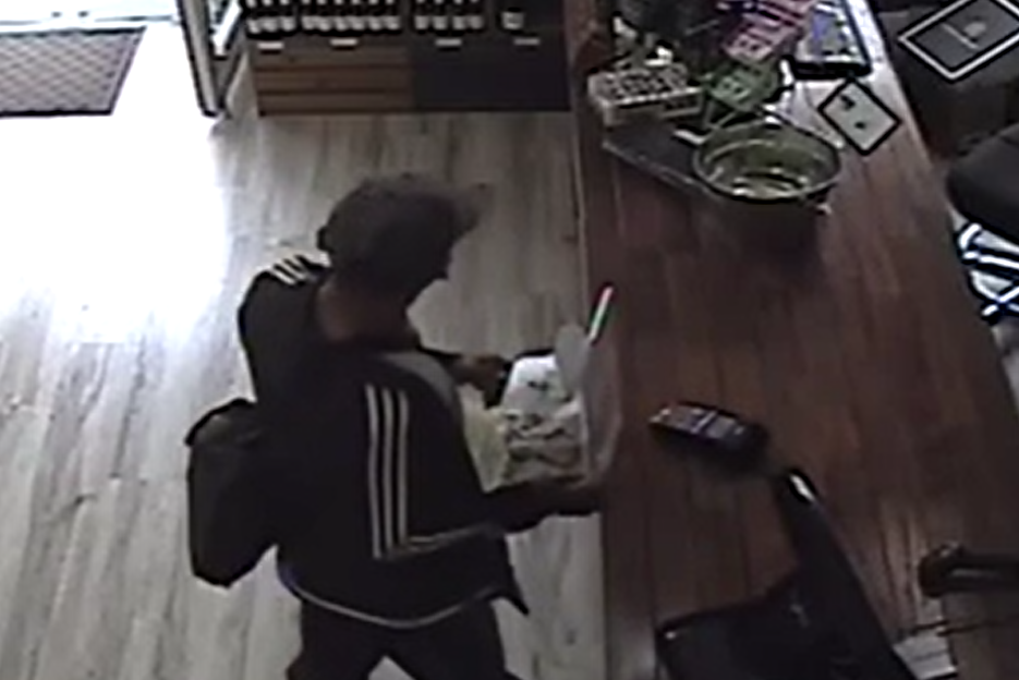 Article image for Bottle shop worker thwarts callous thief's attempt to steal bushfire donation tin