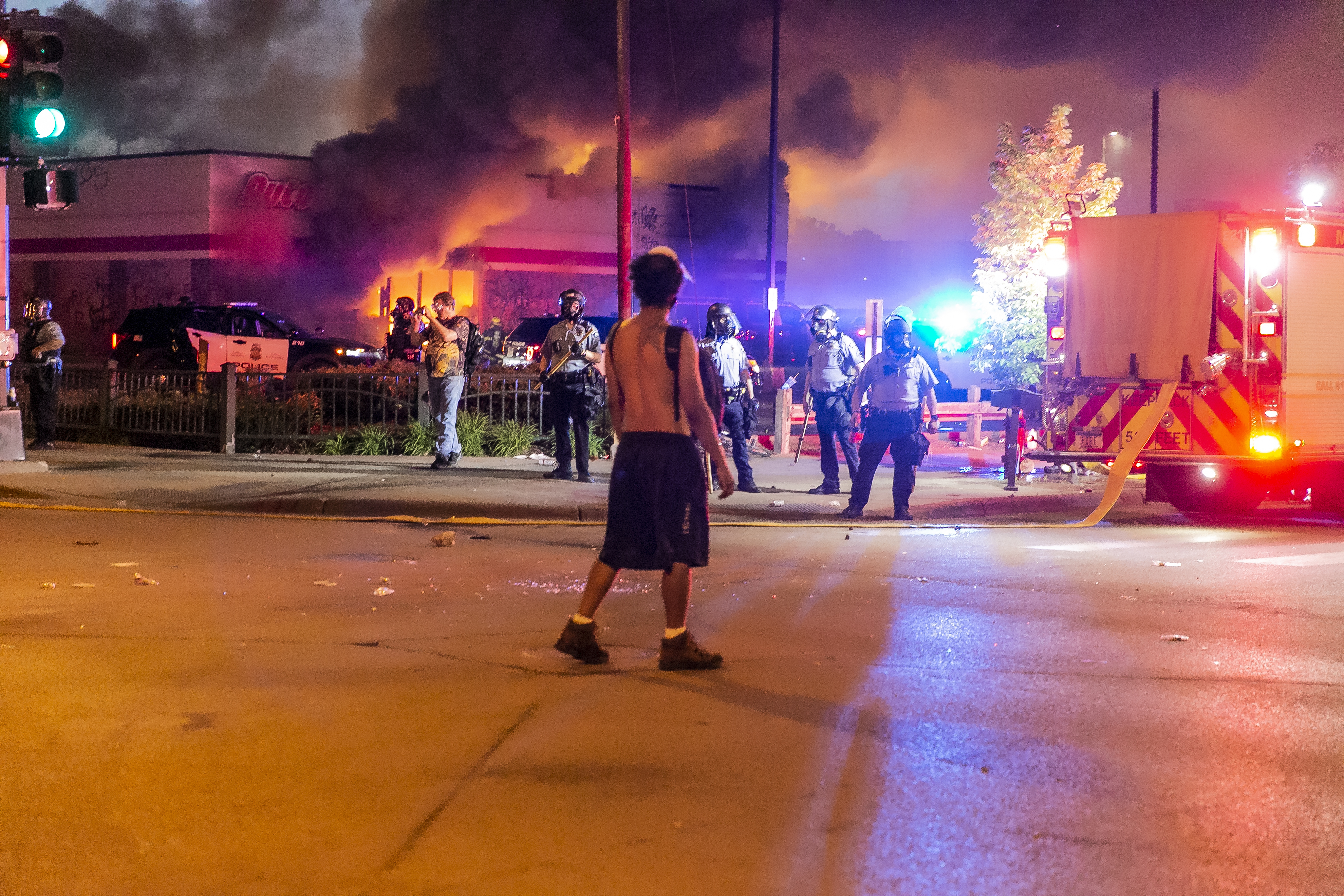 Buildings set alight and shops looted as Minneapolis protests turn violent