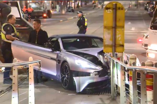 Article image for Woman runs after smashing luxury Aston Martin into CBD bollard