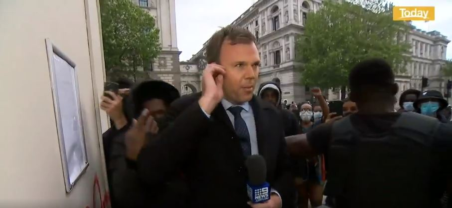 Article image for WATCH: Nine reporter ambushed live on-air covering London protest