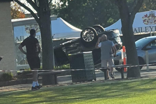 Article image for Car overturns during school pick up in Brighton East