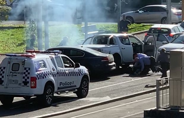 Article image for Two men arrested in dramatic fashion as police swarm on major intersection