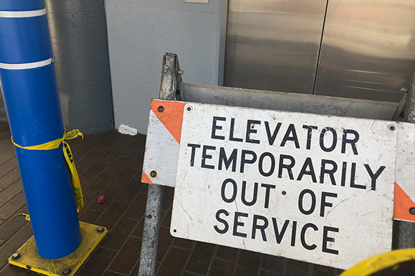 Firefighters trapped in lift after call out to alarm in CBD