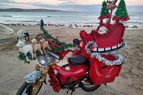 Article image for Why a festive Anglesea mailman has been dobbed in to police