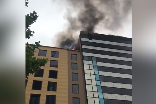 Article image for Rooftop blaze at Queen Street building reignites overnight
