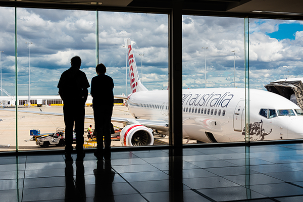 Article image for Race against the clock: Flights from Sydney cancelled as Victorians scramble to get home