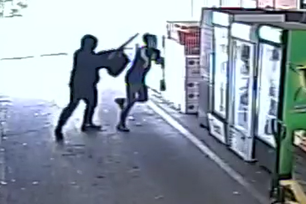 Article image for Frightening footage: Gun-wielding robber holds up Keysborough bottle shop