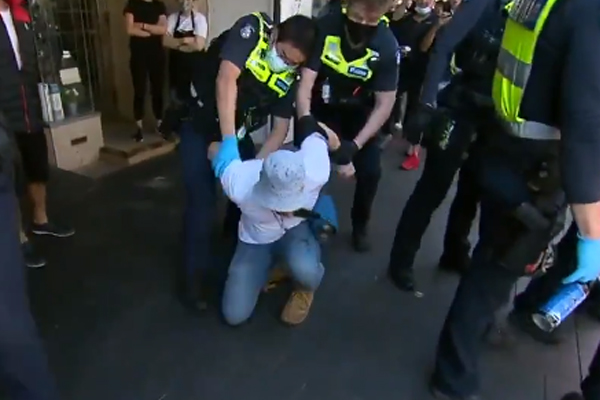 Article image for Three arrested during violent anti-lockdown protest