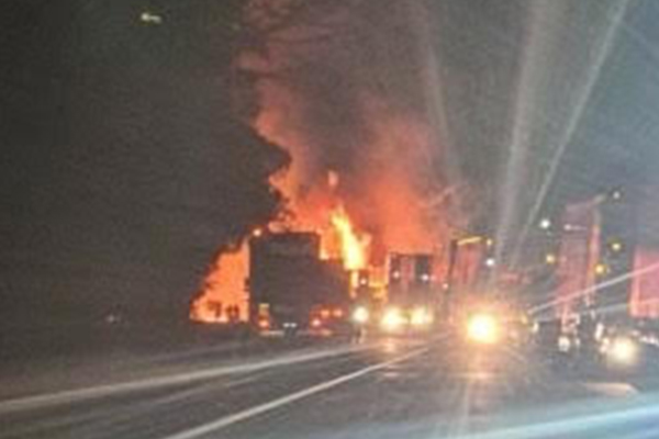 Article image for Fiery crash: Man dead after three trucks collide near border checkpoint
