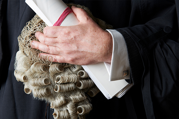 Article image for Almost 100 barristers pen open letter over call to get out of shorts and thongs