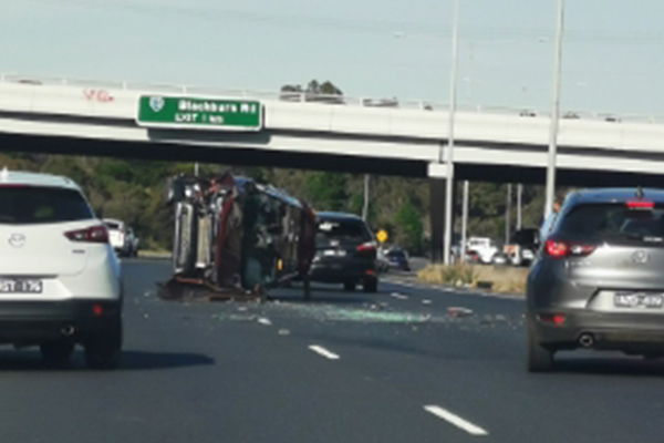Car flips in the middle of the Eastern Freeway