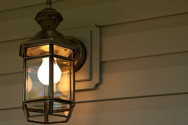 Light globe in lantern on front porch