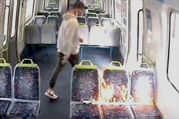 Article image for Police search for man who lit train fire in brazen daylight arson attack