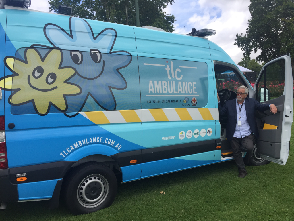 TLC Ambulance for Kids with Neil Mitchell standing in doorway