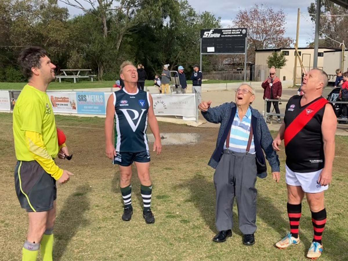 Article image for What a moment! 90-year-old dad tosses coin at sons' football game