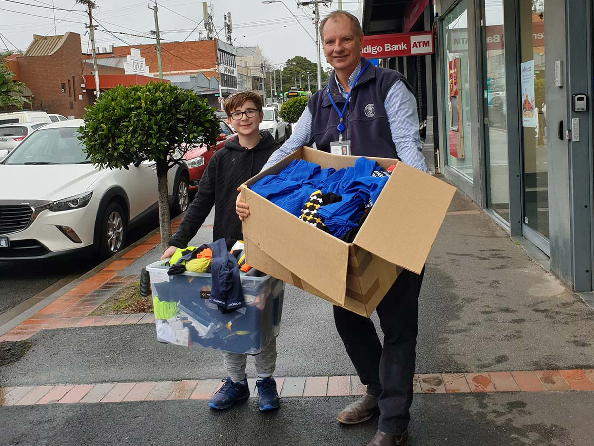Socks4Support founder Benji and MP David Southwick holding boxes of donated socks