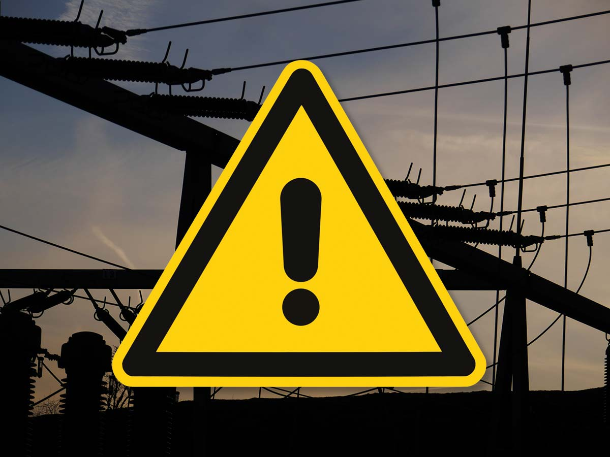 Warning sign over power lines