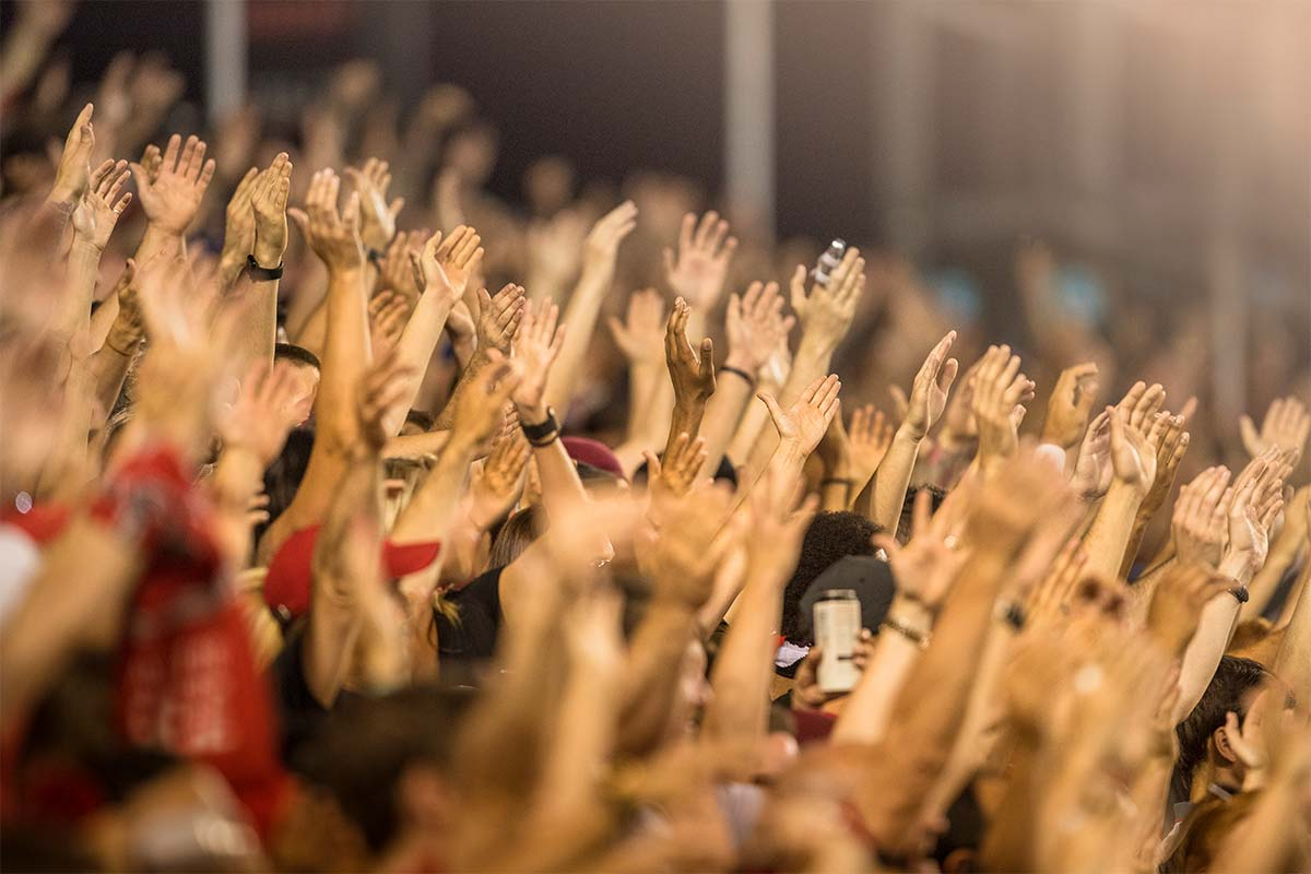 Crowd celebrating with hands in the air