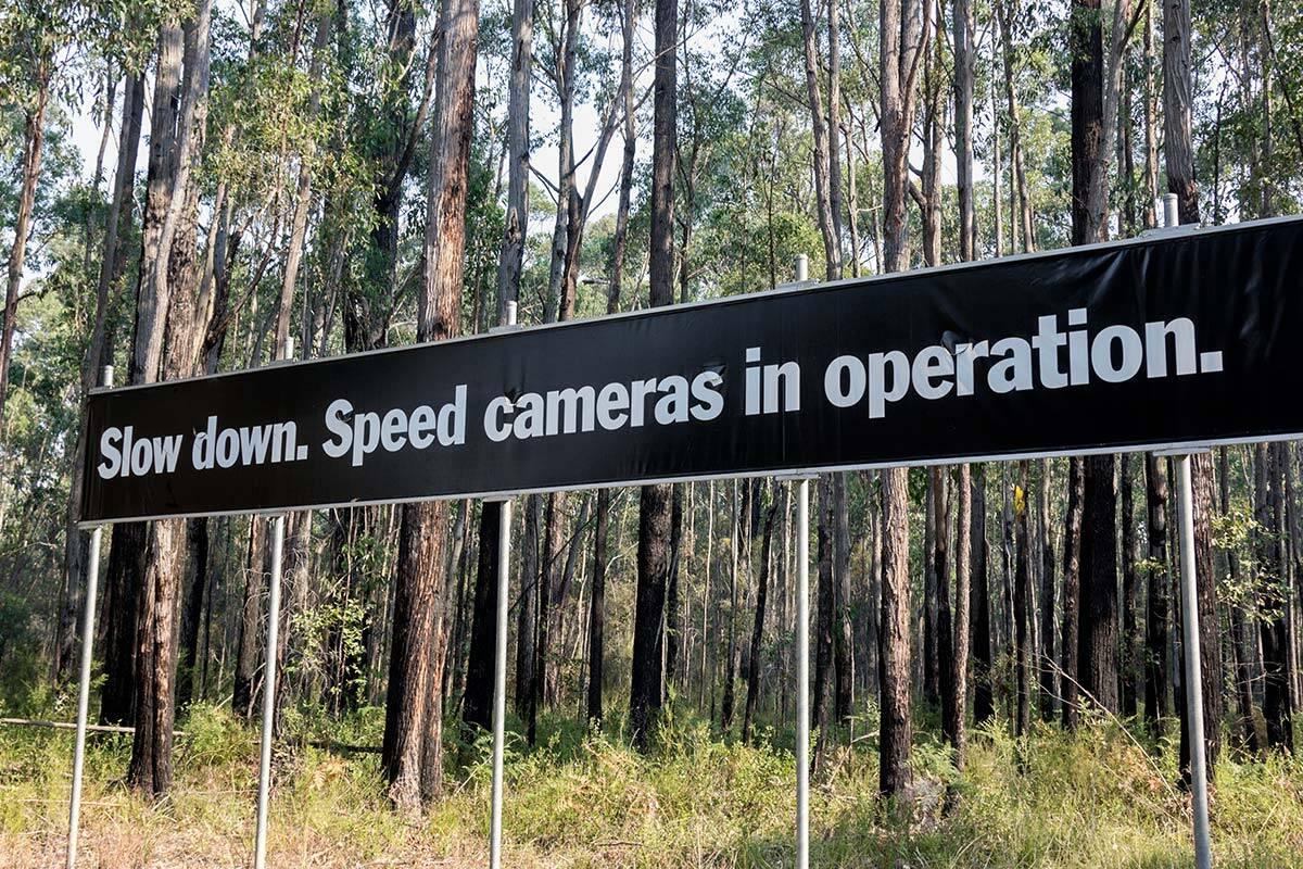 Speed camera sign on roadside