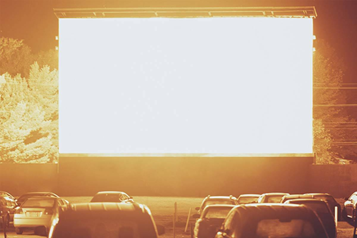 Blank drive in screen with cars waiting