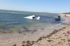 Van ends up in the bay in bungled attempt to get jetski into the ocean