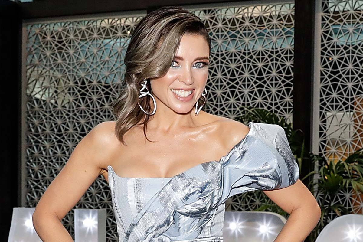Dannii Minogue smiling in a silver dress
