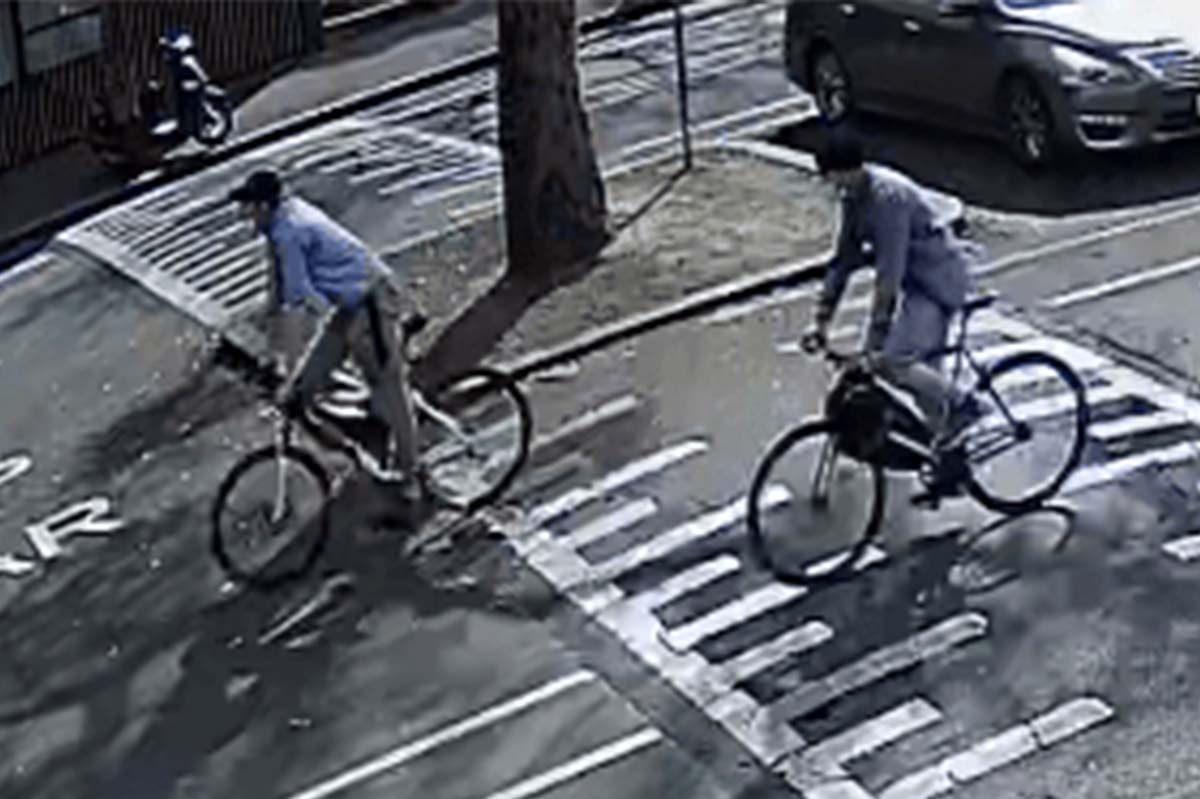 Two men on bikes in West Melbourne